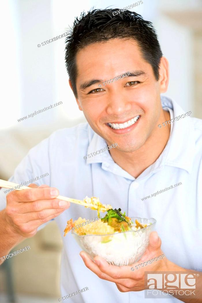 Stock Photo: Man Enjoying Chinese Food With Chopsticks.
