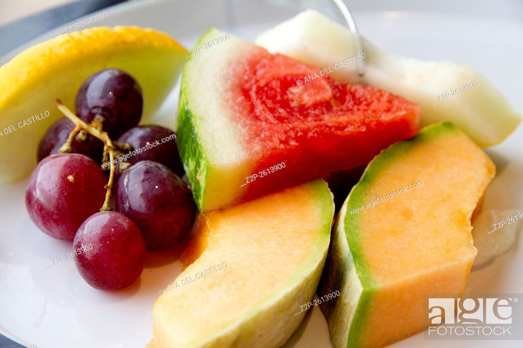Stock Photo: fresh various fruits slices on plate.