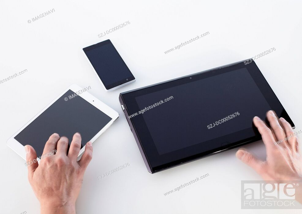 Stock Photo: Hands using smart devices.