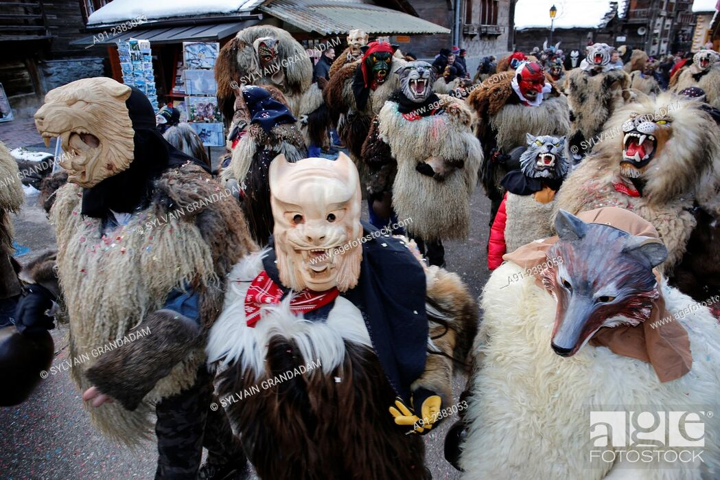"""Stock Photo: Switzerland, Valais, Val d'Herens, village of Evolene, Carnaval, """"""""peluches"""""""" disguisment of young people and children dressed with a coat made of animal fur."""