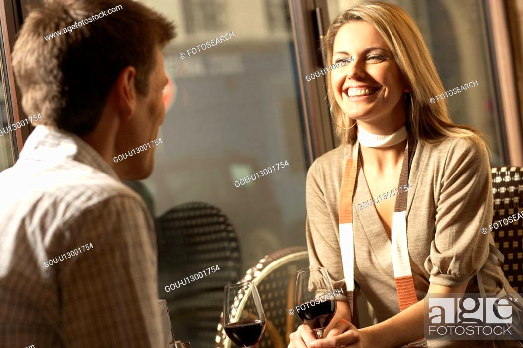 Stock Photo: Mid adult couple drinking red wine.
