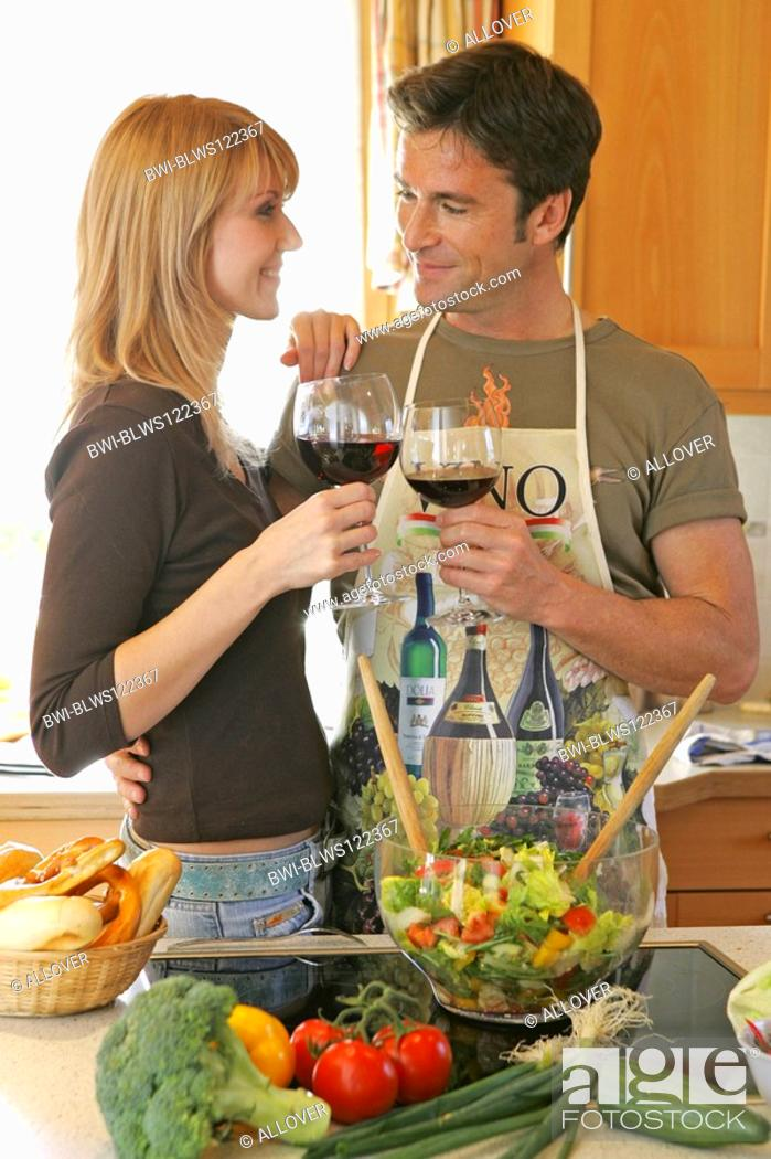 Stock Photo: couple working in the kitchen.
