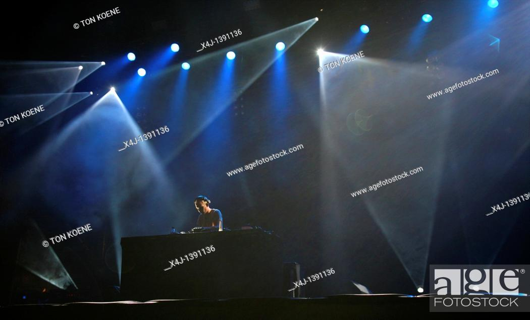Stock Photo: DJ at work with lasershow.