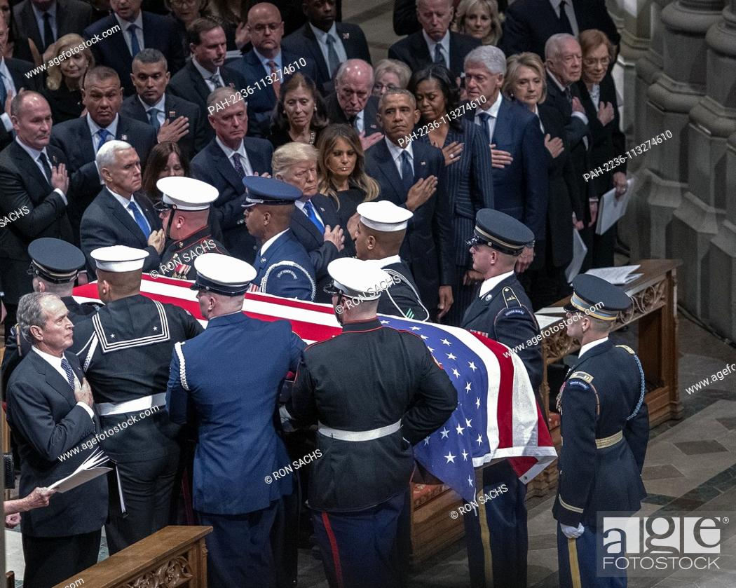 Stock Photo: The Honor Guard carrying the casket containing the remains of former United States President George H.W. Bush is carried out of the Washington National.