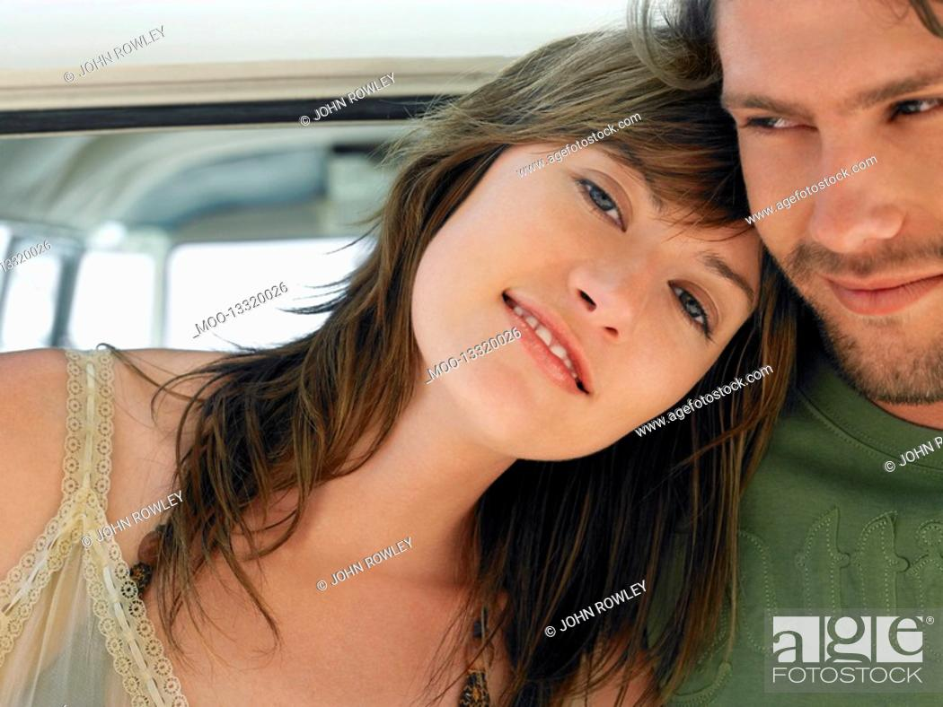 Stock Photo: Young woman leaning on shoulder of young man head and shoulders.