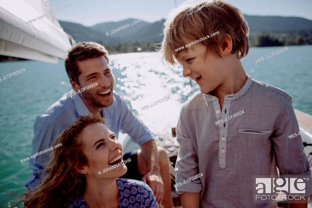 Stock Photo: Happy family on a sailing boat.