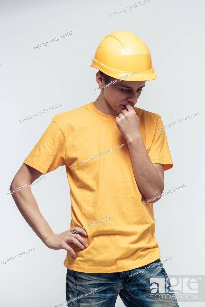 Stock Photo: Worker in yellow helmet upset.