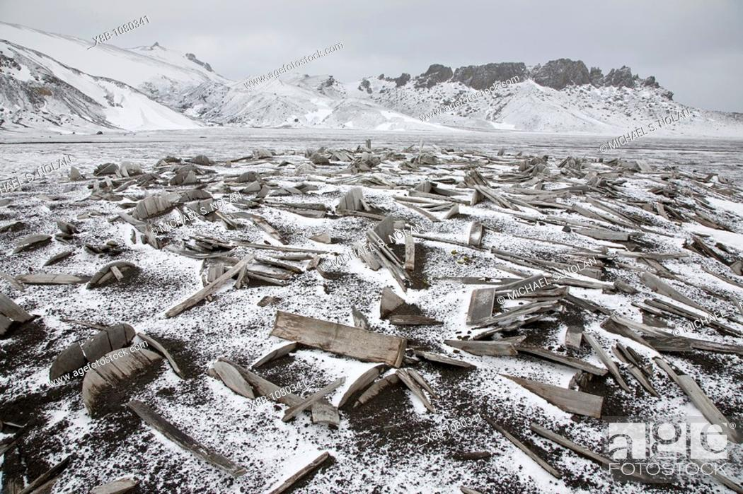 Stock Photo: Snow covering the old barrel staves at Whalers Bay inside of the caldera at Deception Island, South Shetland Islands, Antarctica.