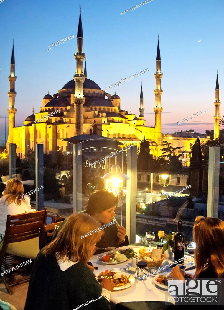 Stock Photo: People dining at The Blue House Hotel Restaurant, Sultanahmet, Istanbul, Turkey.