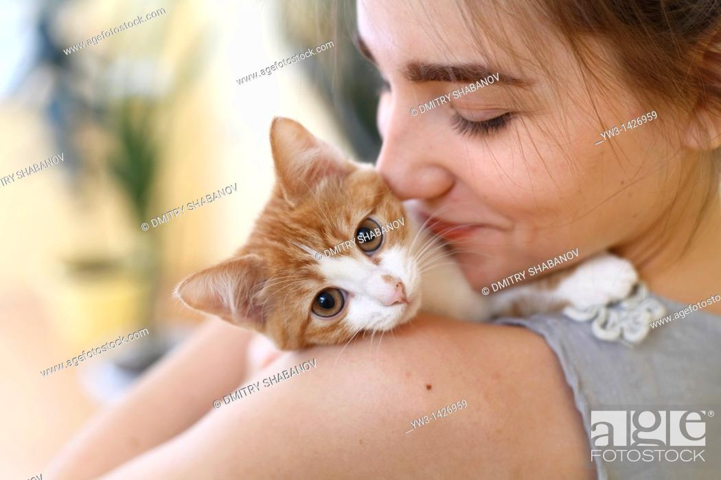 Stock Photo: Happy young woman and red kitten.