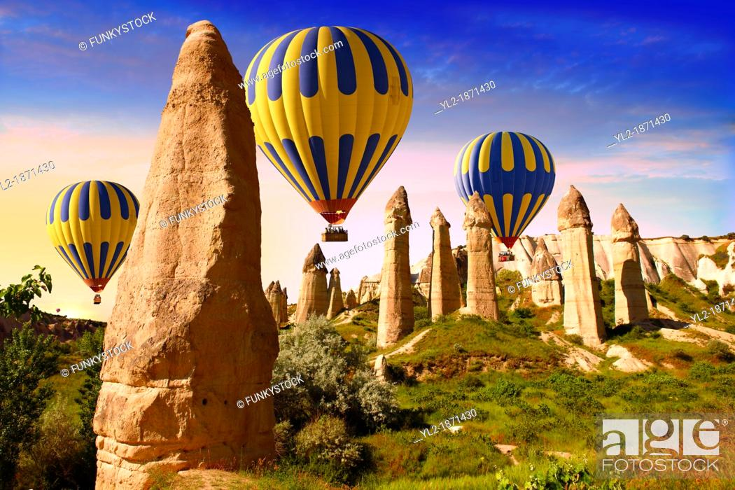 Stock Photo: Hot Air Baloons over the Love Valley at sunrise , Cappadocia Turkey.