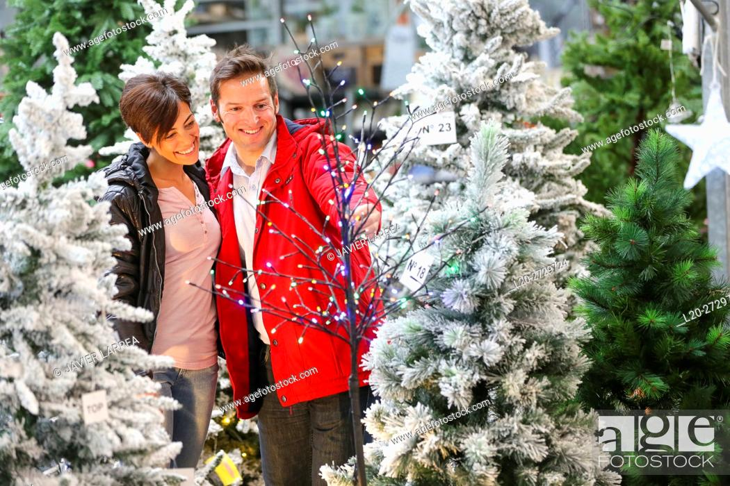 Stock Photo: Couple buying Christmas tree, garden center.