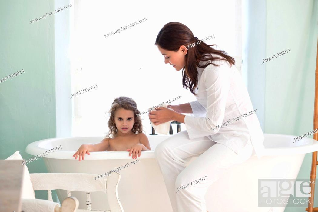 Stock Photo: Woman giving a bath to her daughter.