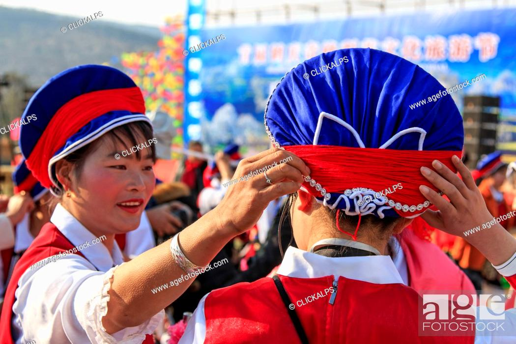 Stock Photo: Chinese women in ancient Bai clothing during the Heqing Qifeng Pear Flower festival, China.