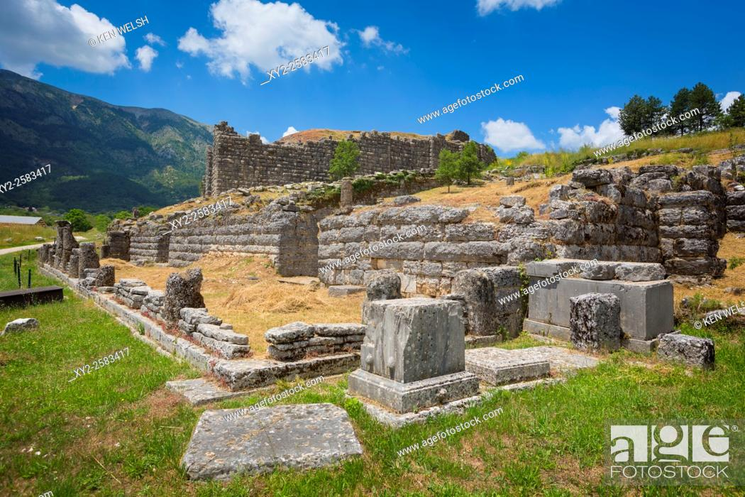 Stock Photo: Greece, Epirus. Ruins of ancient Dodoni. The bouleuterion (or senate house) with the walls of the theatre behind.
