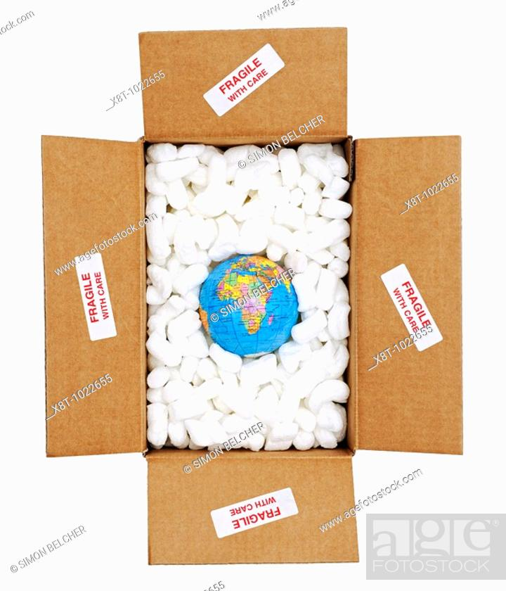 Stock Photo: Globe in Open Cardboard Box Surrounded by Protectve Packing and Marked as Fragile.