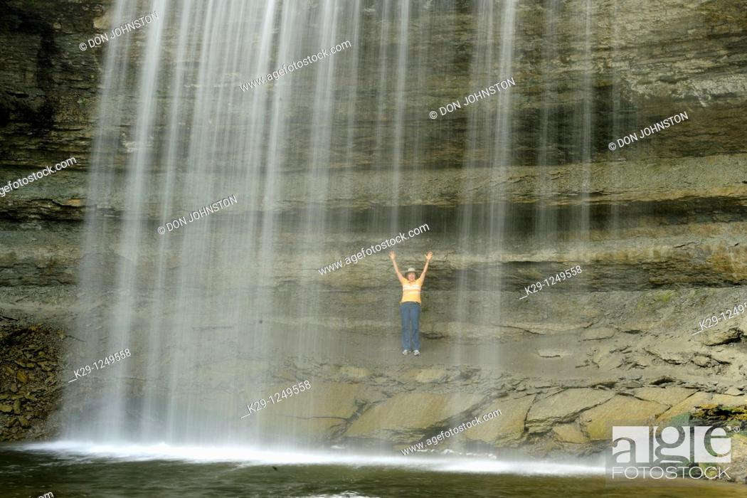 Stock Photo: Visitor standing under Bridal Veil Falls.