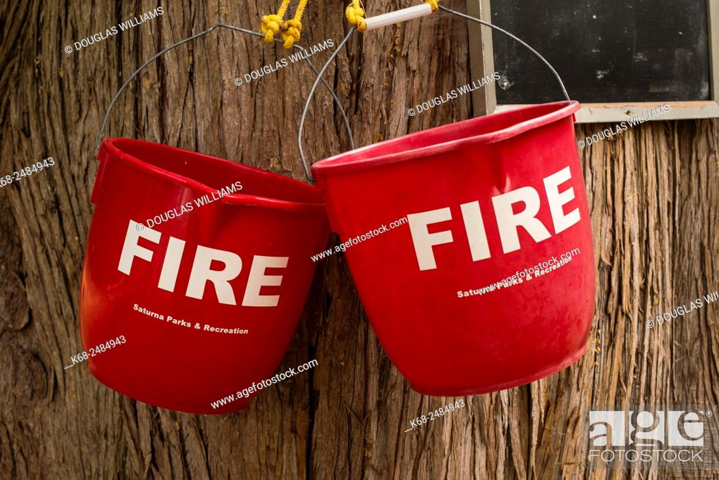Imagen: fire buckets on a tree in Thomson Park, Saturna Island, Gulf Islands, British Columbia, Canada.