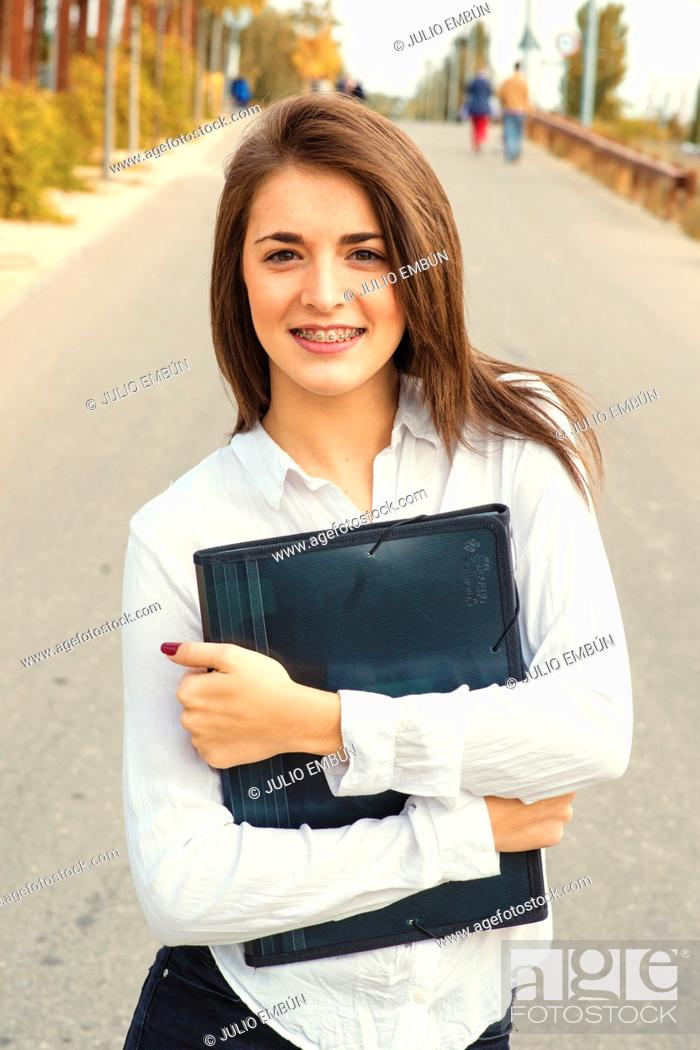 Photo de stock: young teen student with books folder.