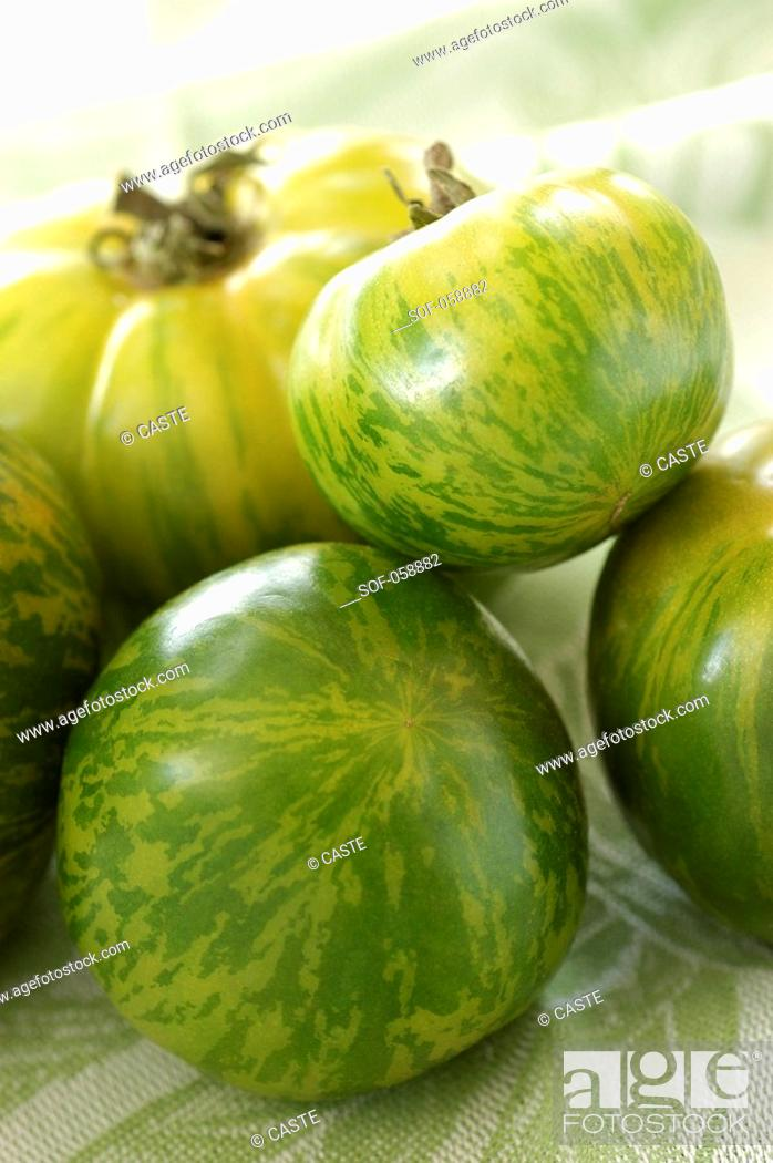 Stock Photo: green tomatoes.