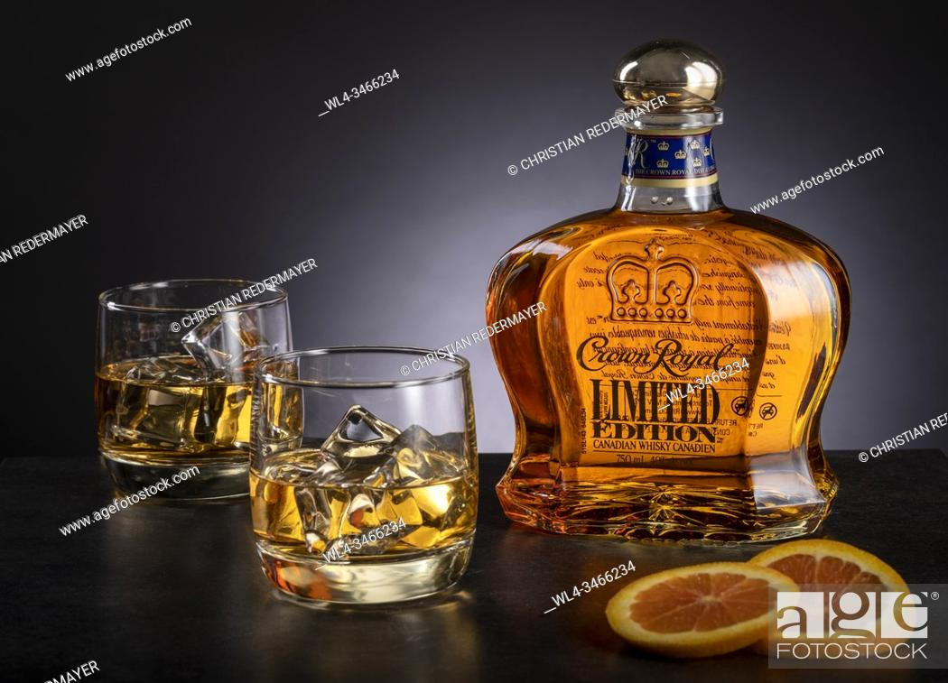 Stock Photo: Whiskey and 2 glasses on wooden black background.