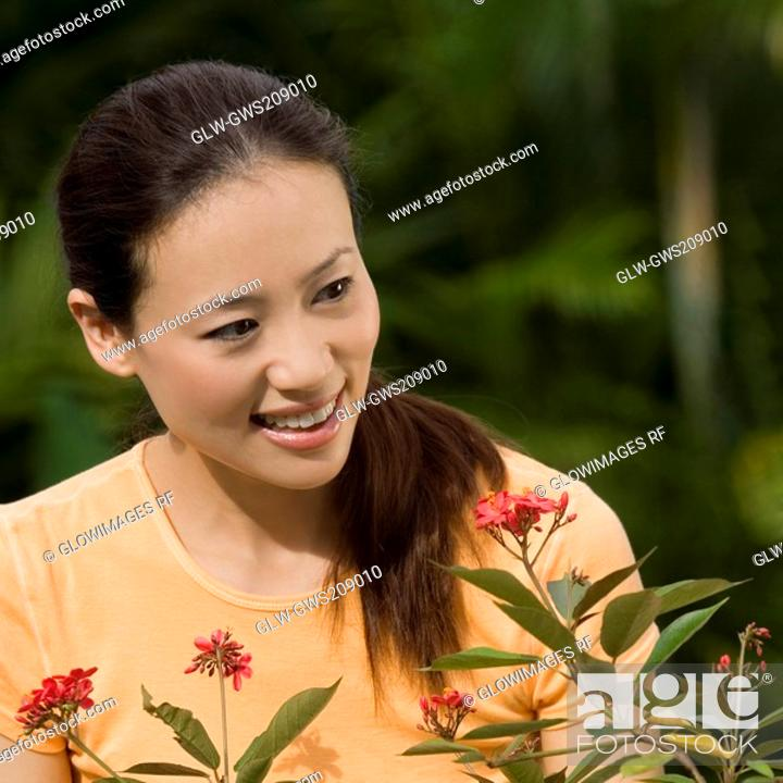 Stock Photo: Close-up of a young woman smiling.