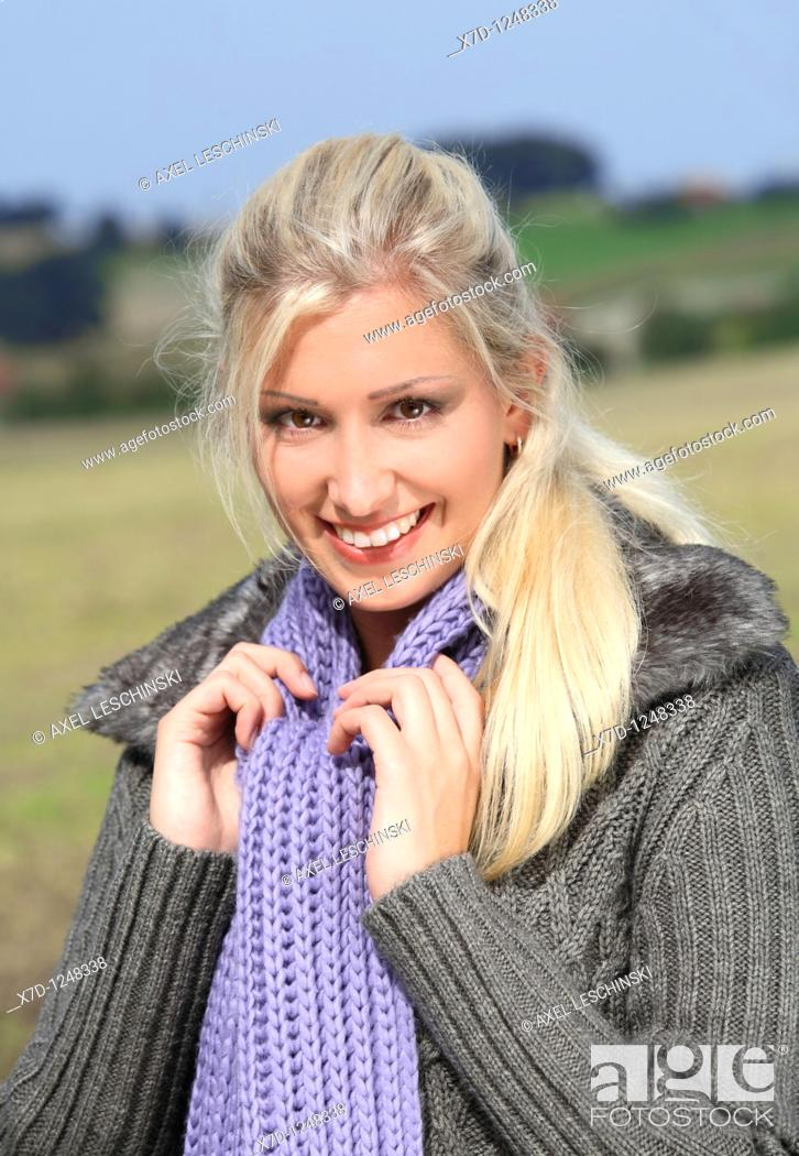 Stock Photo: portrait of blond woman in landscape.
