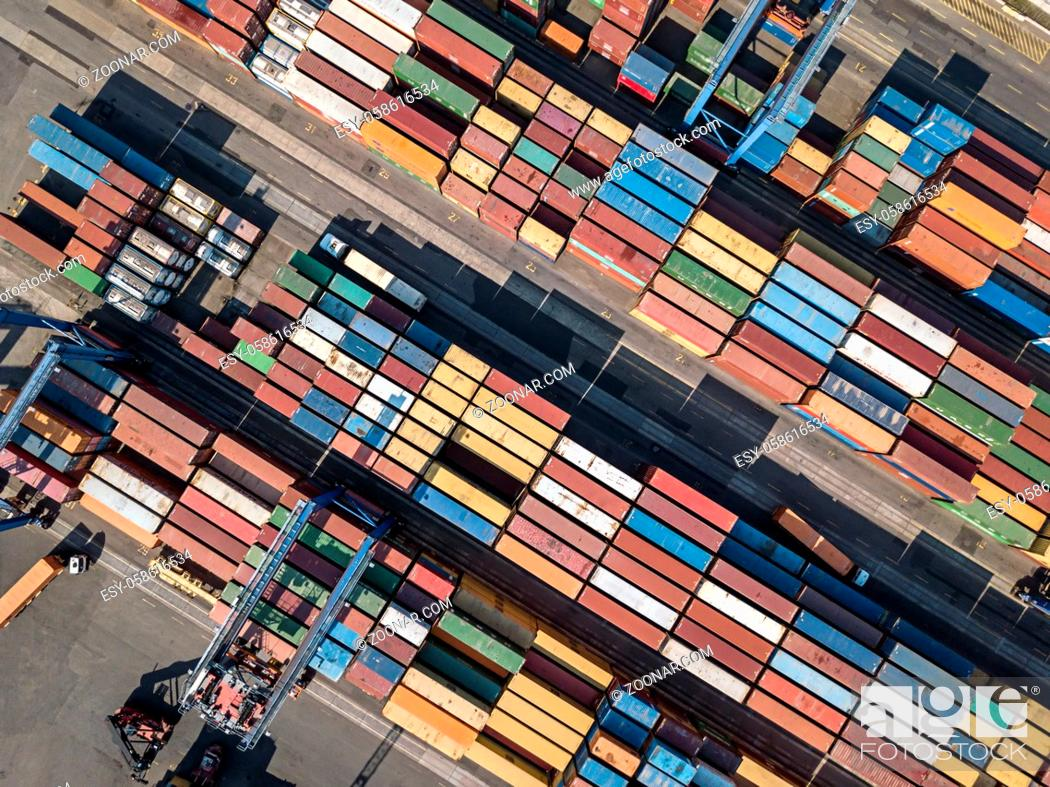 Stock Photo: Top view at the warehouse with many multicolored containers. There are cranes and trucks. Horizontal photo. Outdoors.