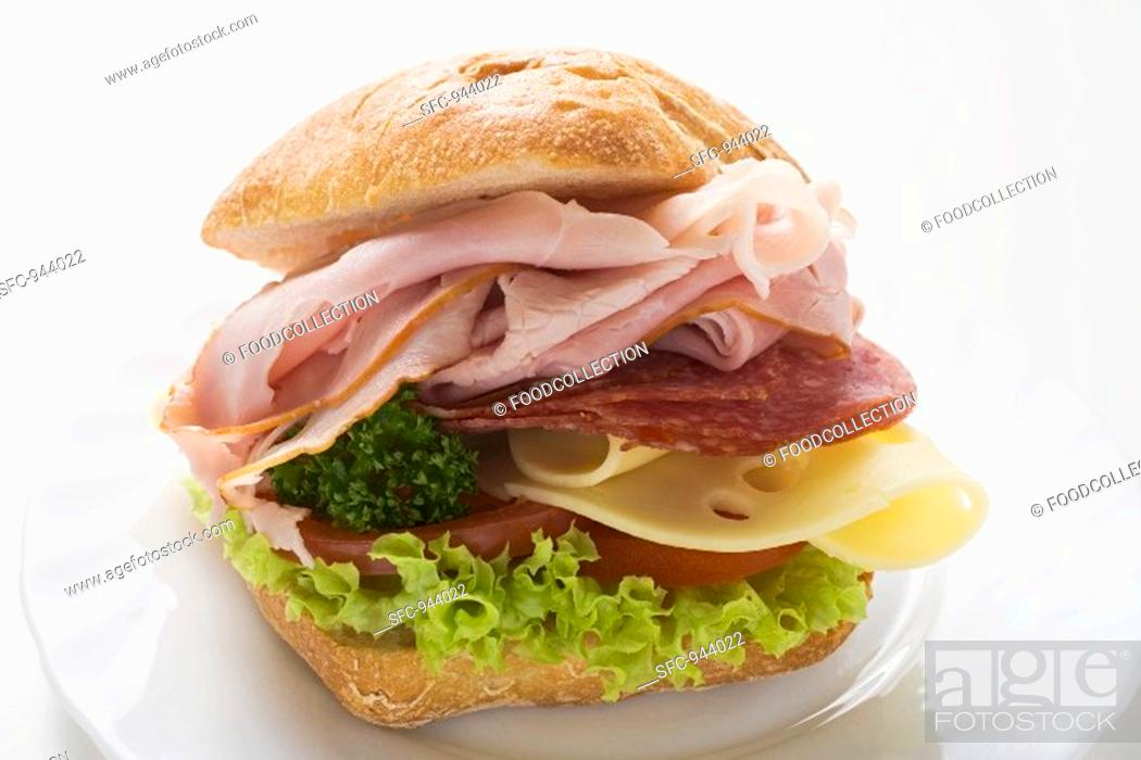 Stock Photo: Ham, salami and cheese sandwich.