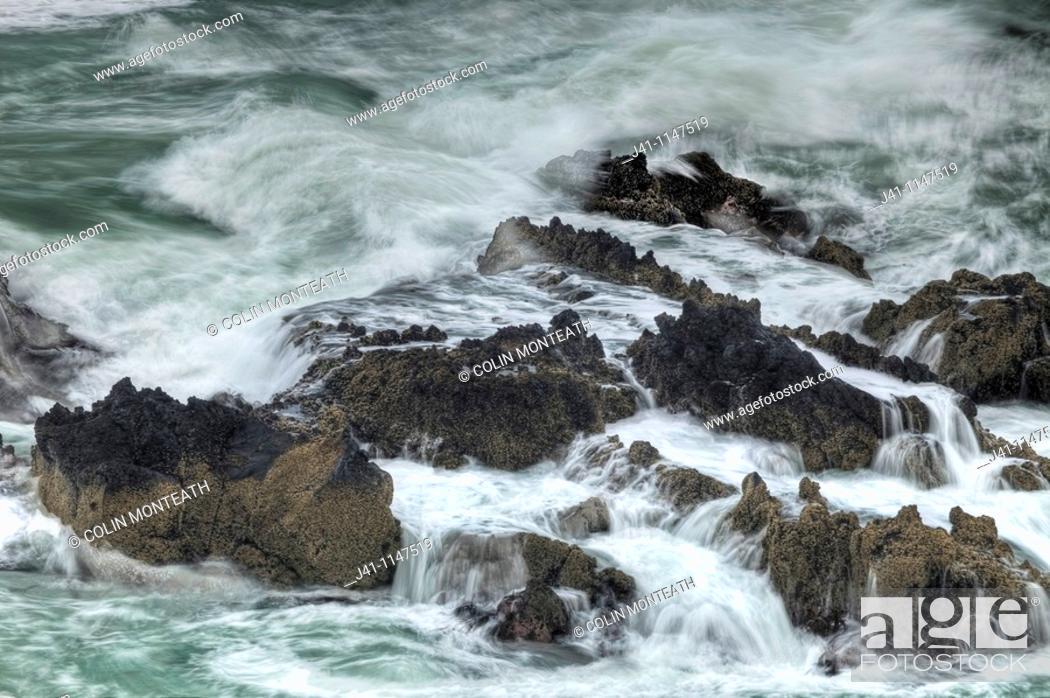 Stock Photo: Surf breaking over rocks, Tumbledown Bay, Banks Peninsula, Canterbury, New Zealand.