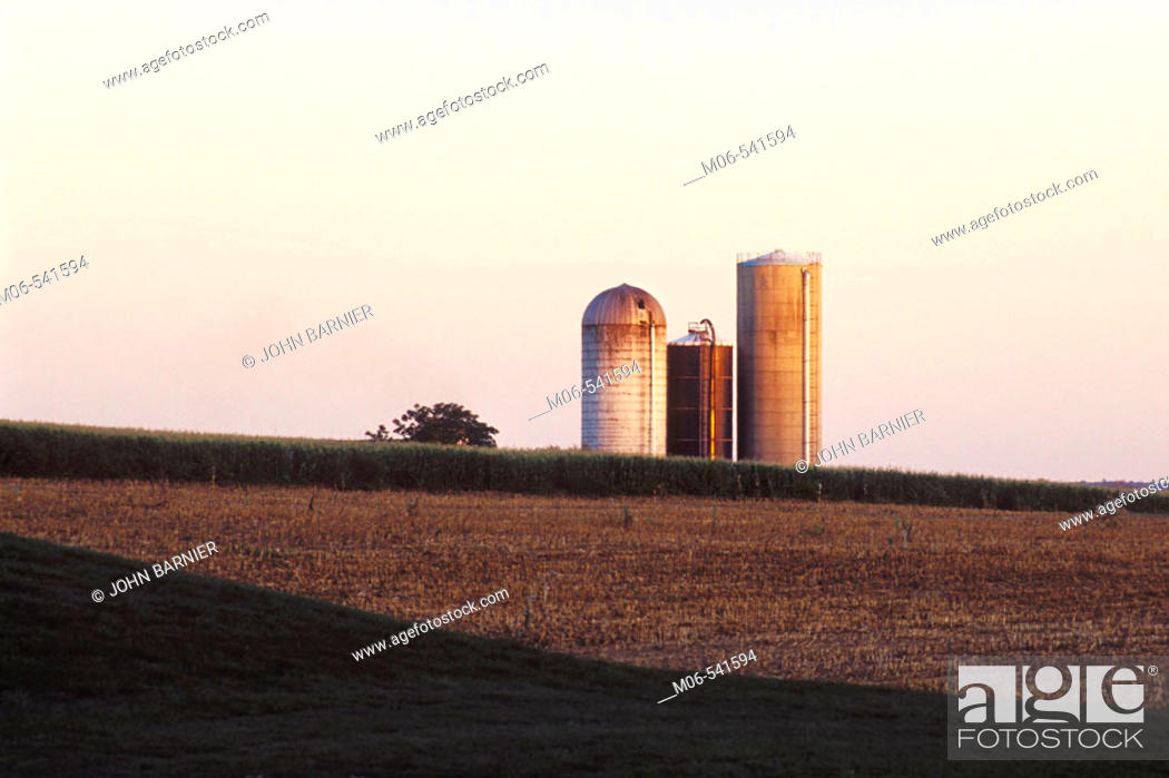Stock Photo: Sunset on a farm in Lancaster County, Pennsylvania. Lancaster County is home to one of the largest populations of Amish and Mennonite farm families in the.
