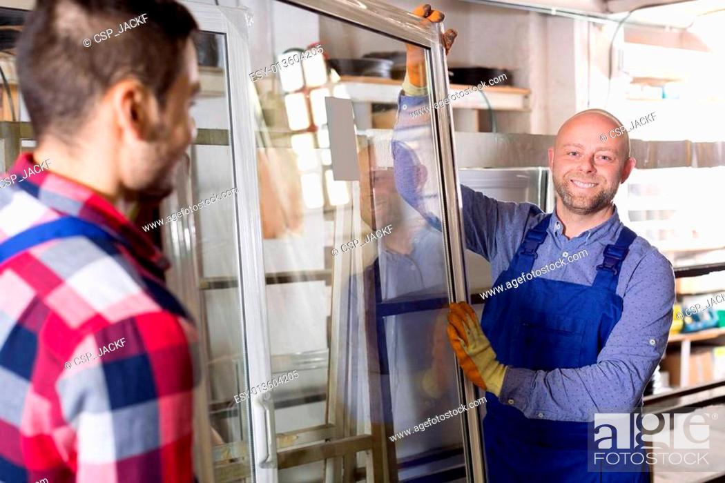 Stock Photo: workmen with windows production.