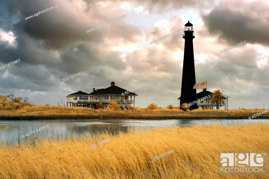 Stock Photo: Early morning light with storm clouds at Point Bolivar Lighthouse, Galveston, Texas, Gulf Coast.