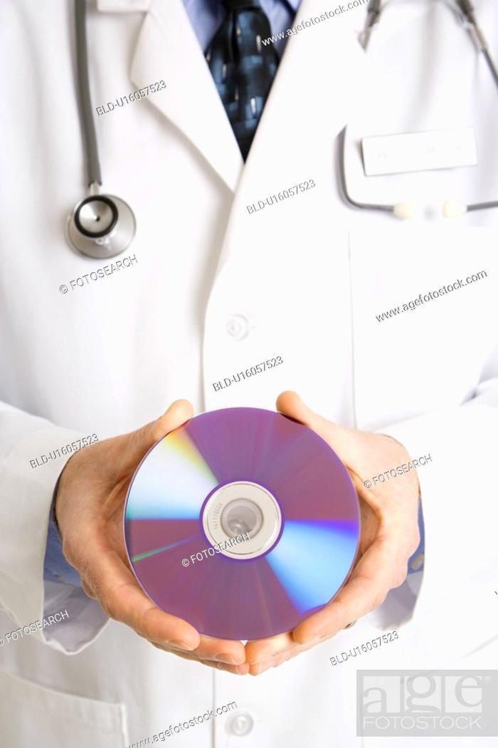 Stock Photo: Close up of physician holding compact disc.