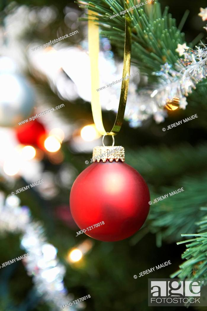 Stock Photo: Red bauble hanging from christmas tree close up.