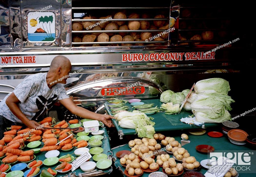 Imagen: Coconut dealer in Manila in Luzon Metro Manila in the Philippines in Southeast Asia Far East.