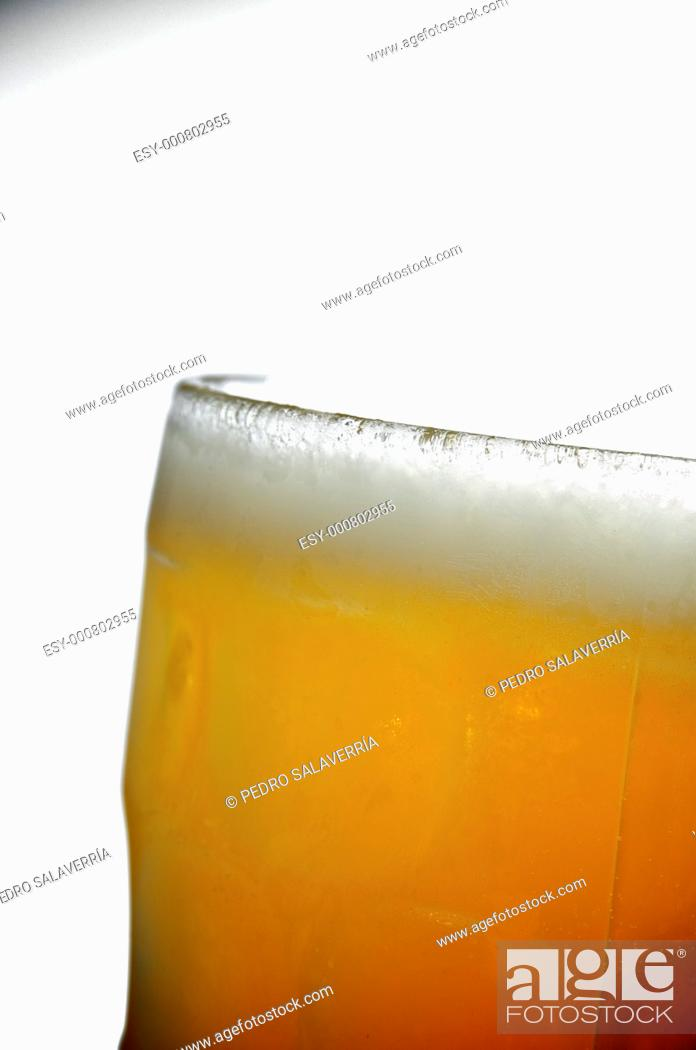 Stock Photo: foreground of a cold pitcher of beer.