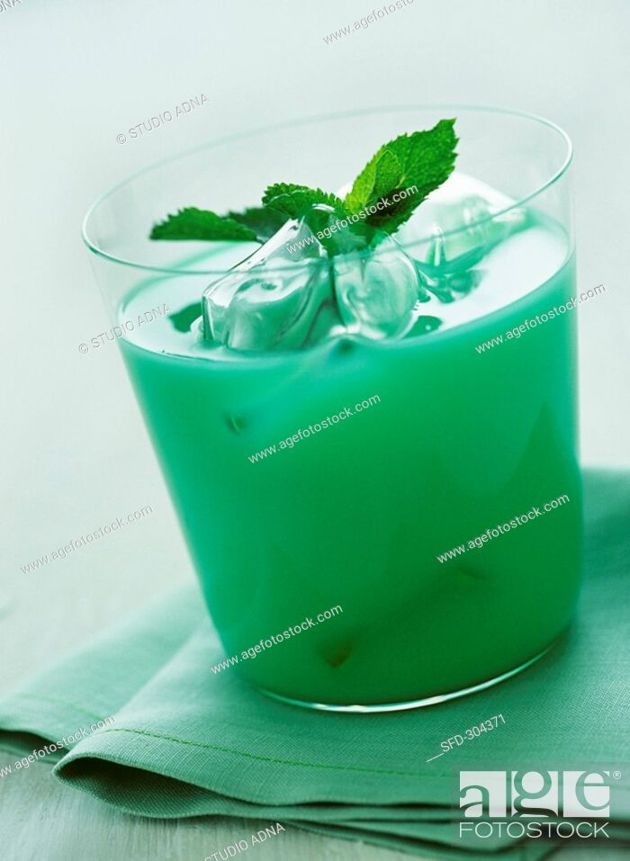 Stock Photo: Green cocktail with ice cubes and mint leaves.