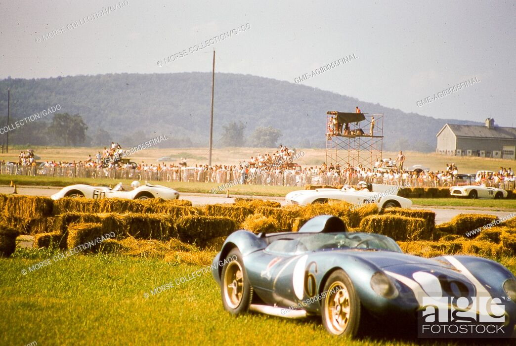 Imagen: View of Lance Reventlow's Mk, August 17, 1958. I Scarab race car No. 6, seen at lower right with a dented front end following a crash into the hay bales lining.