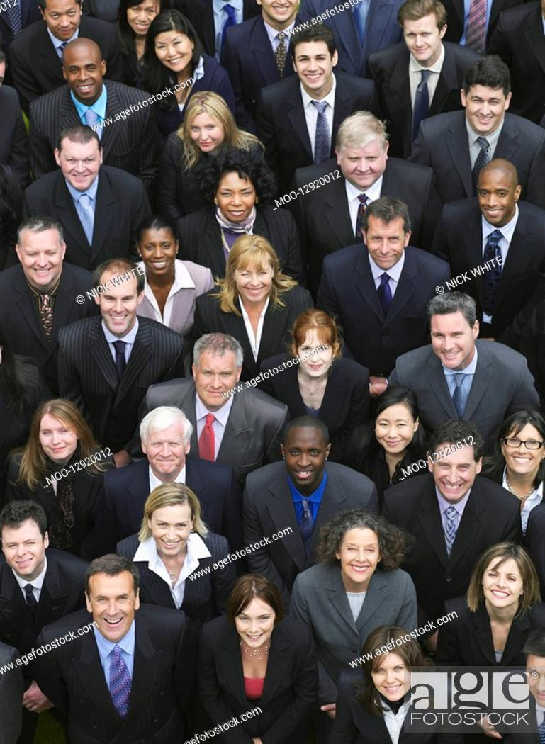 Stock Photo: Large group of business people looking up portrait elevated view.