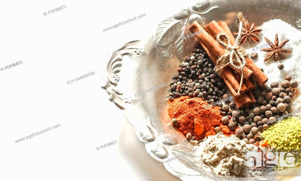 Stock Photo: A variety of Oriental spices on a beautiful plate,isolated on white background, concept of spicy food and spices.