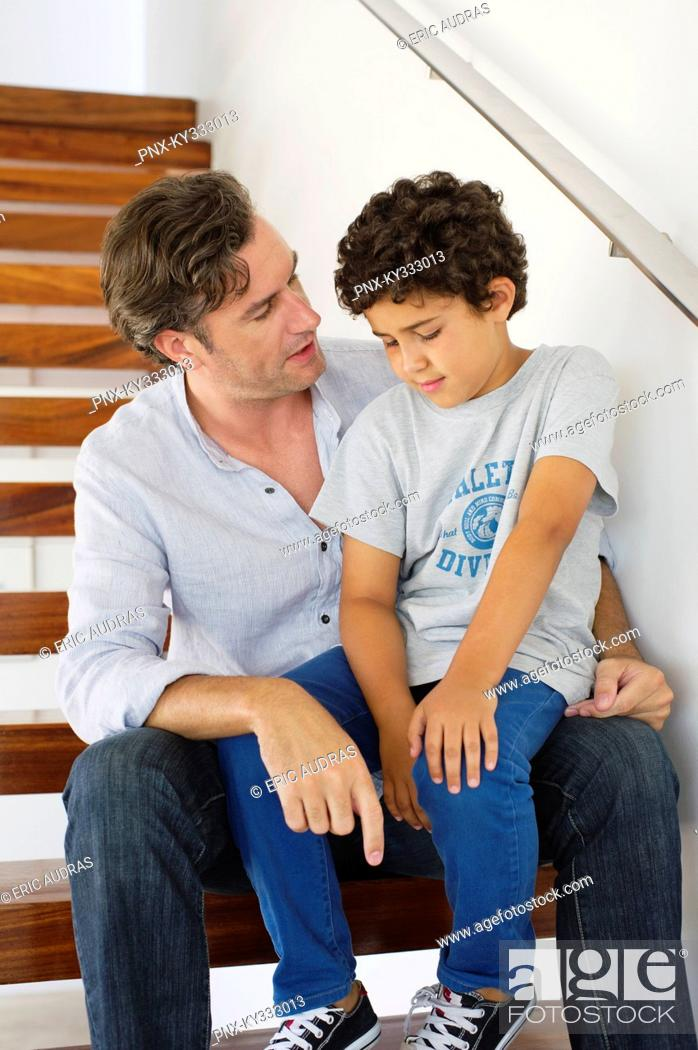 Stock Photo: Mid adult man talking to his son.