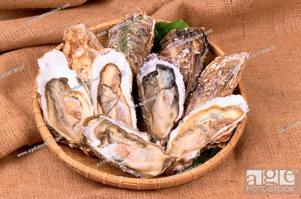 Stock Photo: Plate Of Halved Oysters.