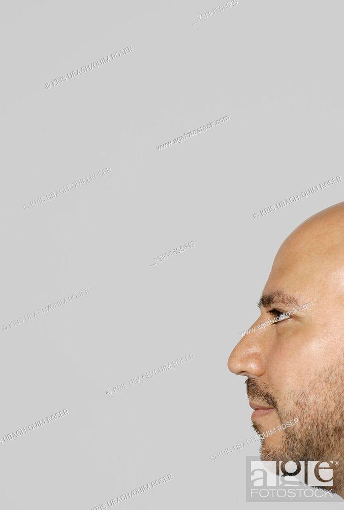 Stock Photo: Studio shot of Mexican man, profile.