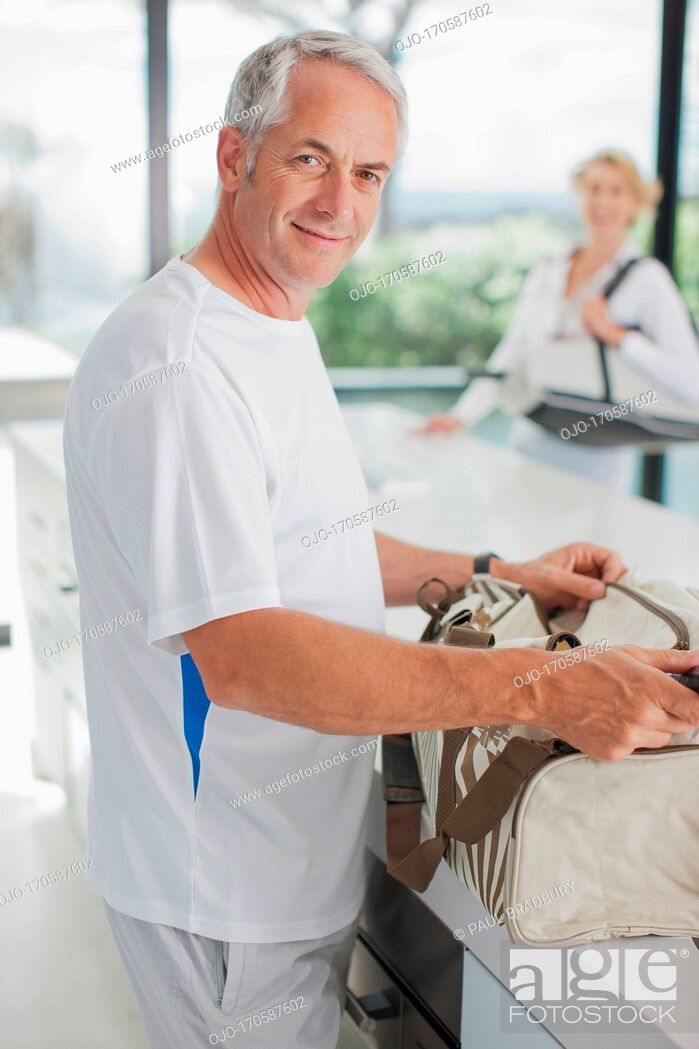 Stock Photo: Man tennis racquet in gym bag.