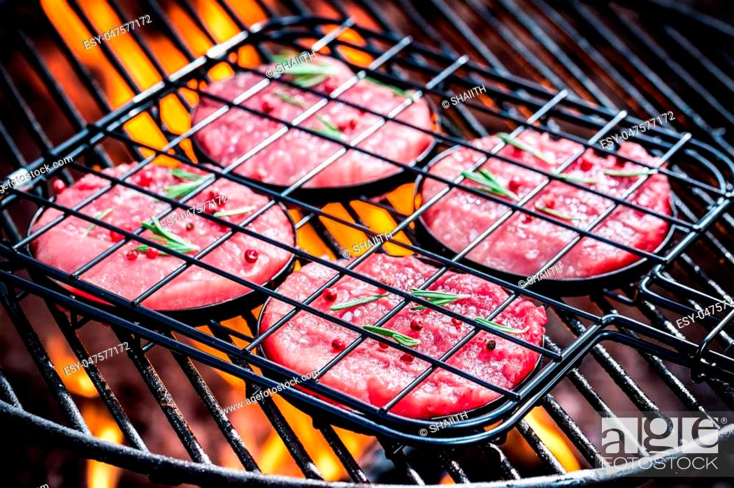 Stock Photo: Roasting red steak with rosemary and pepper.