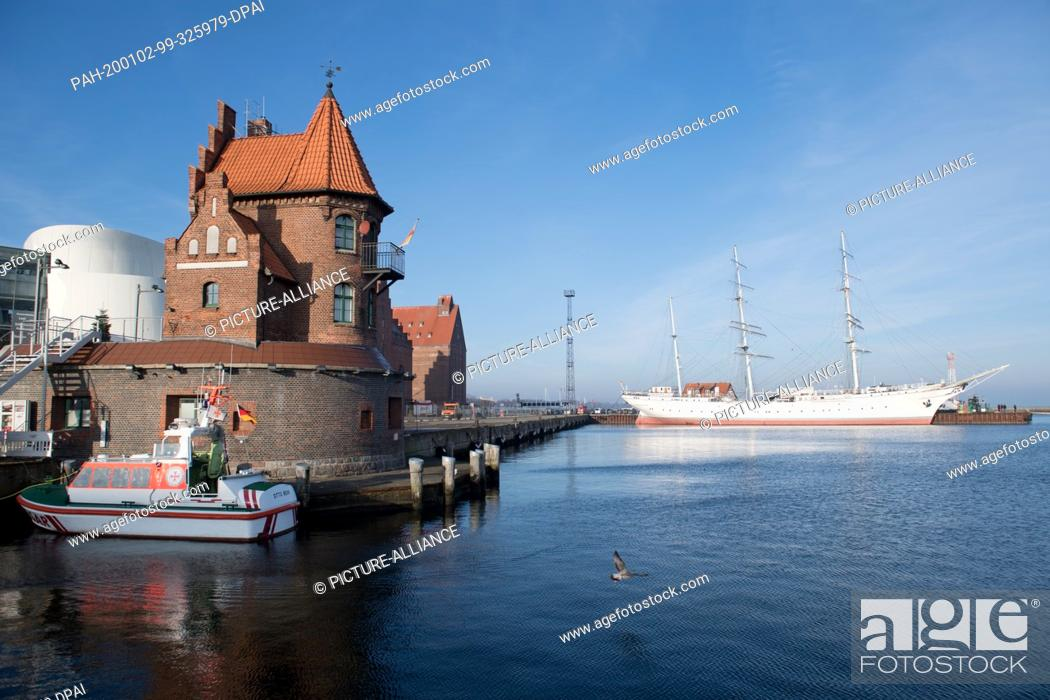 "Stock Photo: 02 January 2020, Mecklenburg-Western Pomerania, Stralsund: In addition to the sailing ship """"Gorch Fock I"""", Stralsund harbour also has an architectural gem in."