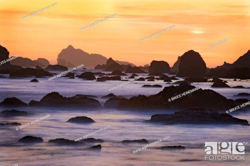 Stock Photo: Sunset and misty waves breaking on beach in Crescent City, California. USA.