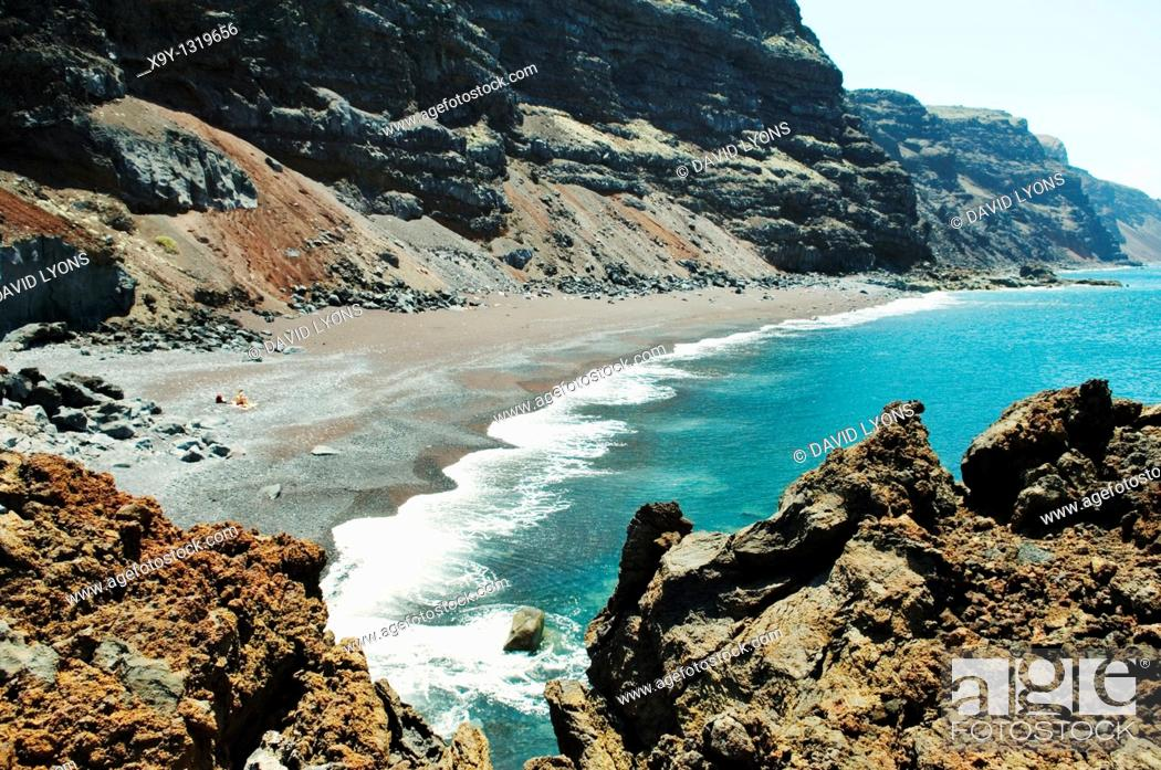 Stock Photo: El Hierro, Canary Islands  The red black volcanic sand beach of the Playa del Verodal is the largest on the island.