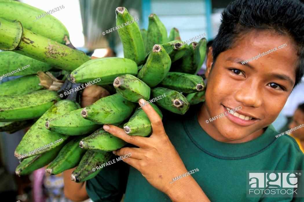 Stock Photo: oceania, samoa, opolu, apia, young man at the market.